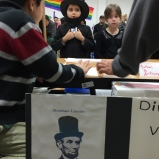 "One of many adorable Abe Lincoln impersonators. Four students chose to study ""Honest Abe,"" an Illinois hero who helped establish our nation's commitment to human rights, a critical dialog now two hundred years in the making. It is important that our students understand the milestones of past and present as they start to define what their impact will be."